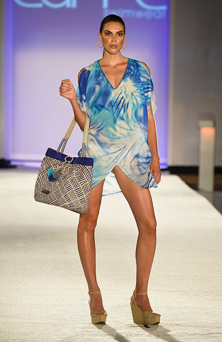 MIAMI BEACH, FL - JULY 18: A model walks the runway at the Caffe Swimwear SS16 Collection during SWIMMIAMI at W South Beach WET on July 18, 2015 in Miami Beach, Florida. (Photo by Frazer Harrison/Getty Images for Caffe Swimwear)