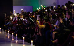 The audience pulled out their phones to light the runway for models when the lights went out during part of the show.
