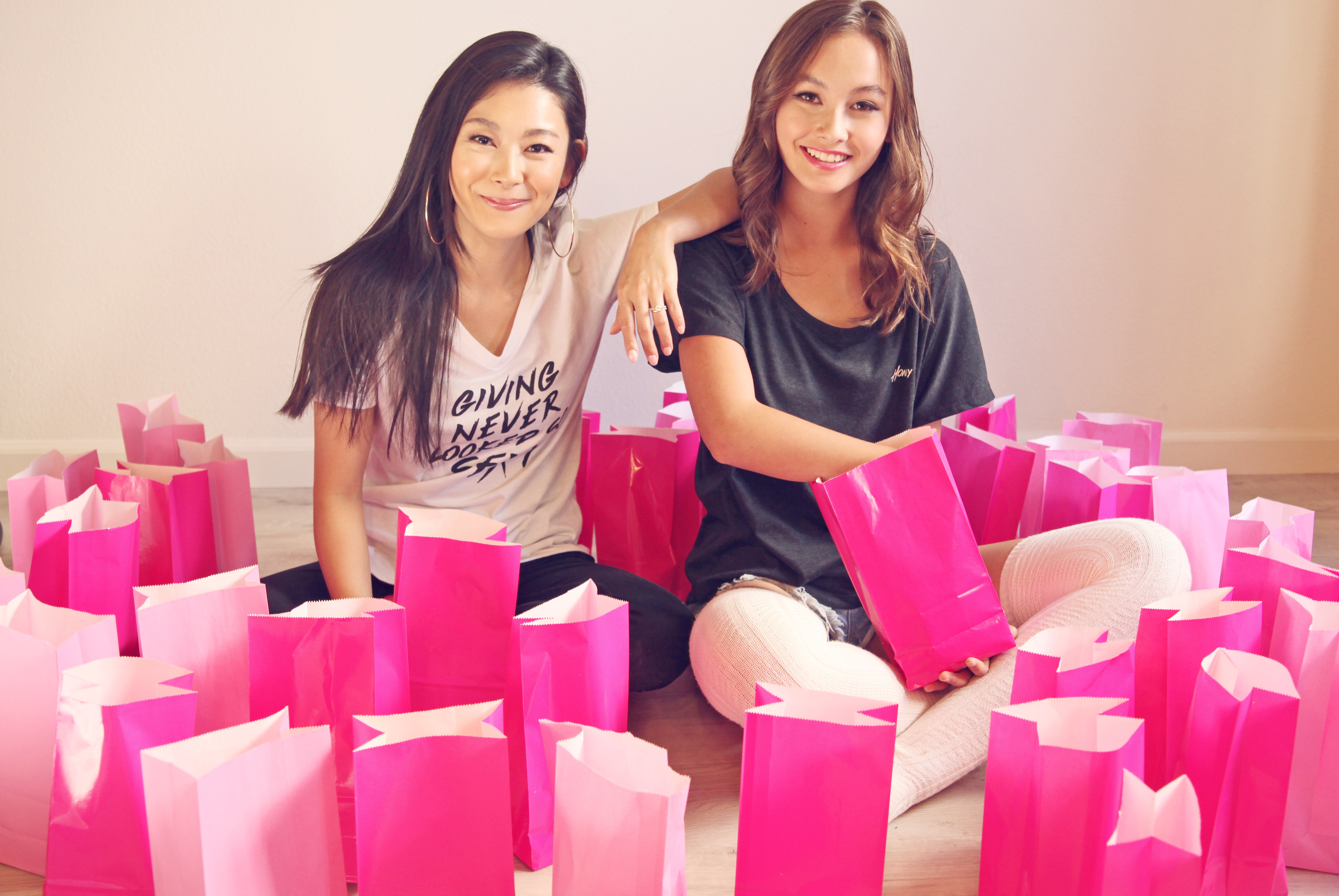 Honey Coast USA Founder Violet Su packing goodie bags for donators
