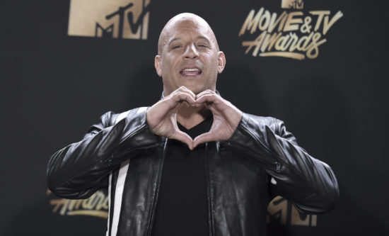 "Vin Diesel, winner of the Generation award for ""The Fast and the Furious"", poses in the press room at the MTV Movie and TV Awards at the Shrine Auditorium on Sunday, May 7, 2017, in Los Angeles. (Photo by Richard Shotwell/Invision/AP)"