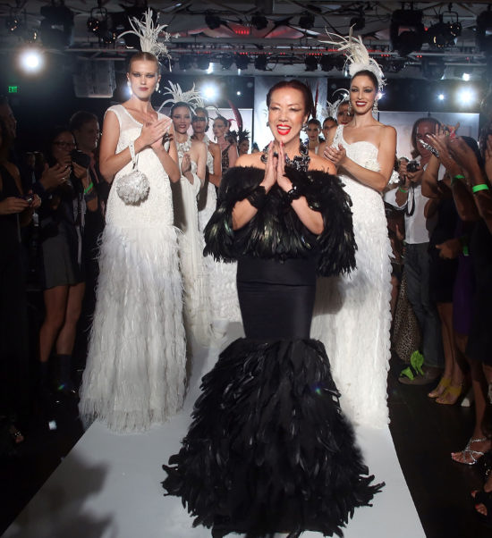 LOS ANGELES, CA - SEPTEMBER 21: Designer Sue Wong walks the runway during the Sue Wong Spring Transcendent Fashion Show at The Conga Room at L.A. Live on September 21, 2012 in Los Angeles, California. (Photo by Rachel Murray/WireImage)